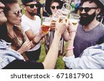 group of friends drinking a... | Shutterstock . vector #671817901