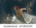 gold mining underground | Shutterstock . vector #671822104