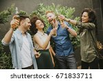 group of friends having outdoor ... | Shutterstock . vector #671833711