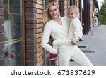 mother with the daughter before ... | Shutterstock . vector #671837629