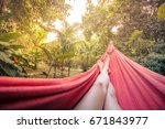 girl lying in a hammock in the... | Shutterstock . vector #671843977