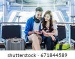 happiness asian couple traveler ... | Shutterstock . vector #671844589