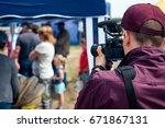 the cameraman  videographer ...   Shutterstock . vector #671867131