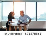 young man and woman discussing... | Shutterstock . vector #671878861