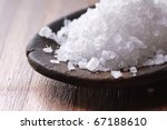 sea salt in a wooden spoon - stock photo
