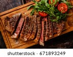 sliced grilled beef barbecue... | Shutterstock . vector #671893249