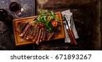 sliced grilled beef barbecue... | Shutterstock . vector #671893267