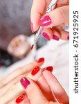 manicure in progress  ... | Shutterstock . vector #671925925