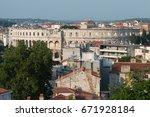 antique roman amphitheater in...   Shutterstock . vector #671928184