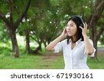 woman listening music media... | Shutterstock . vector #671930161