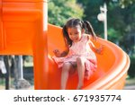 cute asian child girl having... | Shutterstock . vector #671935774