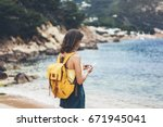 hipster girl with backpack hold ... | Shutterstock . vector #671945041