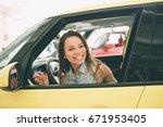 beautiful young woman buying a... | Shutterstock . vector #671953405