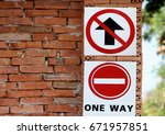 one way sign on brick wall  | Shutterstock . vector #671957851