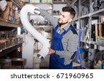 young male worker choosing...   Shutterstock . vector #671960965