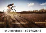 sport. the cyclist rides on his ... | Shutterstock . vector #671962645