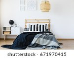 comfortable bed with wooden... | Shutterstock . vector #671970415