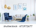 white sofa and blue armchair in ...