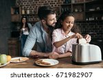 smiling father with adorable... | Shutterstock . vector #671982907