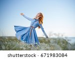 woman in a chamomile field      ... | Shutterstock . vector #671983084