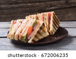 club sandwich with bacon ... | Shutterstock . vector #672006235