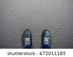 caution  wet floor. black shoes ... | Shutterstock . vector #672011185