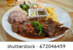 Steak Rice And French Fries In...