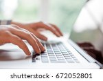 hands with laptop typing  | Shutterstock . vector #672052801