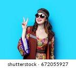 portrait of young hippie girl... | Shutterstock . vector #672055927