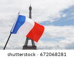 flag of france against eiffel... | Shutterstock . vector #672068281
