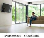 young handsome man enjoying... | Shutterstock . vector #672068881