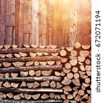 Stacked Firewood Heap Against...