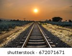 Sunset On The Train Tracks In...
