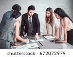 manager discussing work with...   Shutterstock . vector #672072979