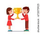 smiling winners kids boy  girl... | Shutterstock .eps vector #672075925