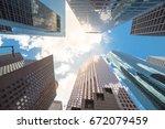upward view of skyscrapers...   Shutterstock . vector #672079459