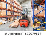 forklift in warehouse storage... | Shutterstock . vector #672079597