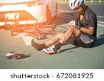 asia cyclist injured on the... | Shutterstock . vector #672081925