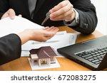 women taking keys from real... | Shutterstock . vector #672083275