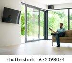 young handsome man enjoying... | Shutterstock . vector #672098074