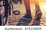 closeup of hipster man feet and ... | Shutterstock . vector #672114835