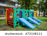 playground colorful on grass | Shutterstock . vector #672148111