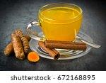 herbal tea with turmeric powder ... | Shutterstock . vector #672168895