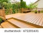 wooden deck of family home. | Shutterstock . vector #672201631