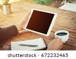 business man using tablet on...   Shutterstock . vector #672232465