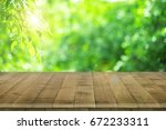 empty wooden table for product... | Shutterstock . vector #672233311