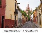 san miguel de allende street... | Shutterstock . vector #672235024