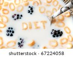 The word DIET spelled out of letter shaped cereal pieces floating in a milk filled cereal bowl. - stock photo