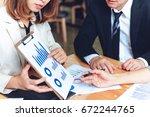 business women show present at... | Shutterstock . vector #672244765