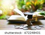 graduation cap on saving coins... | Shutterstock . vector #672248431